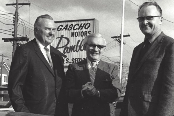 gascho team standing in front of gascho motors sign