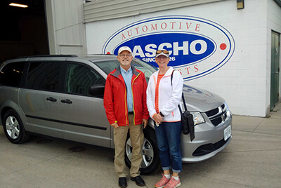 Happy couple with new van