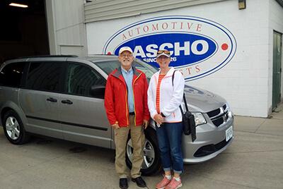 Happy couple with new van
